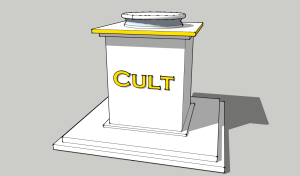 "A pedestal with a golden engraving saying ""Cult""."